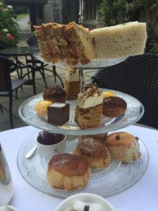 cakes and sandwiches displayed on a cake stand