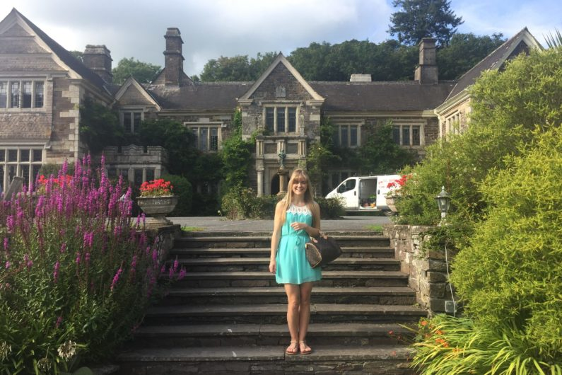 Abi standing outside Lewtrenchard Manor
